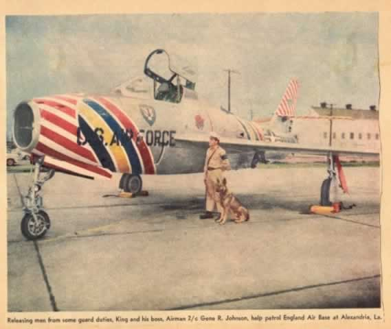 Airmman and his guard dog on patrol over a F-84F Thunderstreak at EAFB