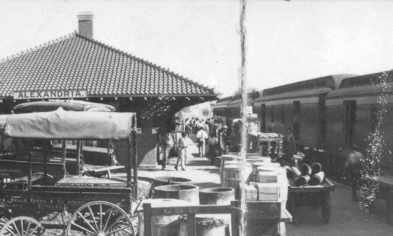Union Station, Alexandria, Louisiana, circa 1910-15, with horse-drawn wagons meeting the train