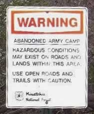 Warning: Abandoned Army Camp. Use open roads and trails with caution