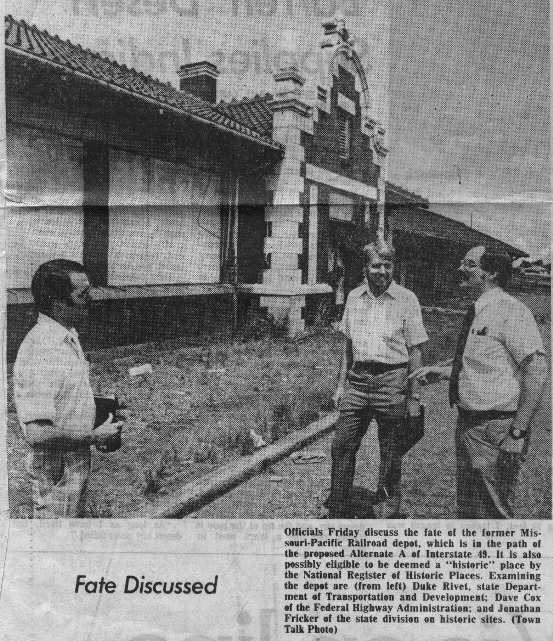 "Officials discuss the fate of the former Missouri-Pacific Railroad depot, which is in the path of the proposed Alternate A route of Interstate 49. It is also possibly eligible to be deemed a ""historic"" place by the National Register of Historic Places. Examining the depot are (from left) Duke Rivet, State Department of Transportation & Development (DOTD), Dave Cox of the Federal Highway Administration, and Jonathan Fricker of the state division on historic sites."